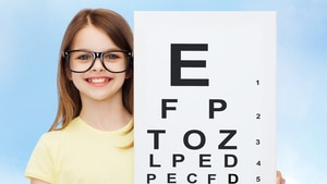 child with eye chart